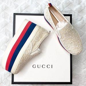 GUCCI Lace sneaker w/ striking striped platform